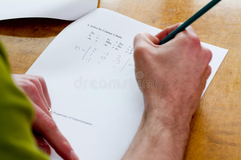 Final exam. With engineering math question partially worked out by mature student / continuing education royalty free stock photos
