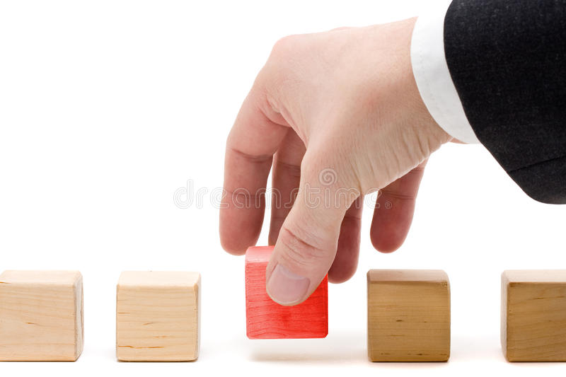 The final piece. Business man putting the final piece into place - achievement concept royalty free stock photos
