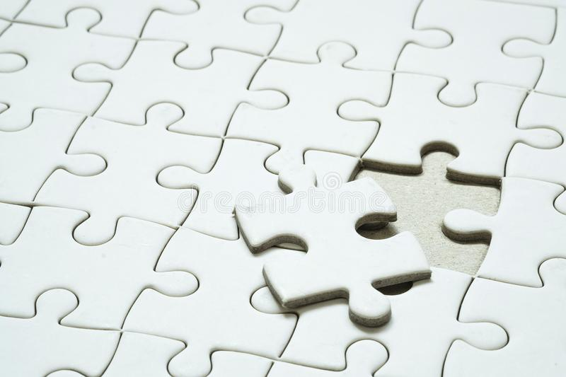 Final piece of jigsaw puzzle. stock image