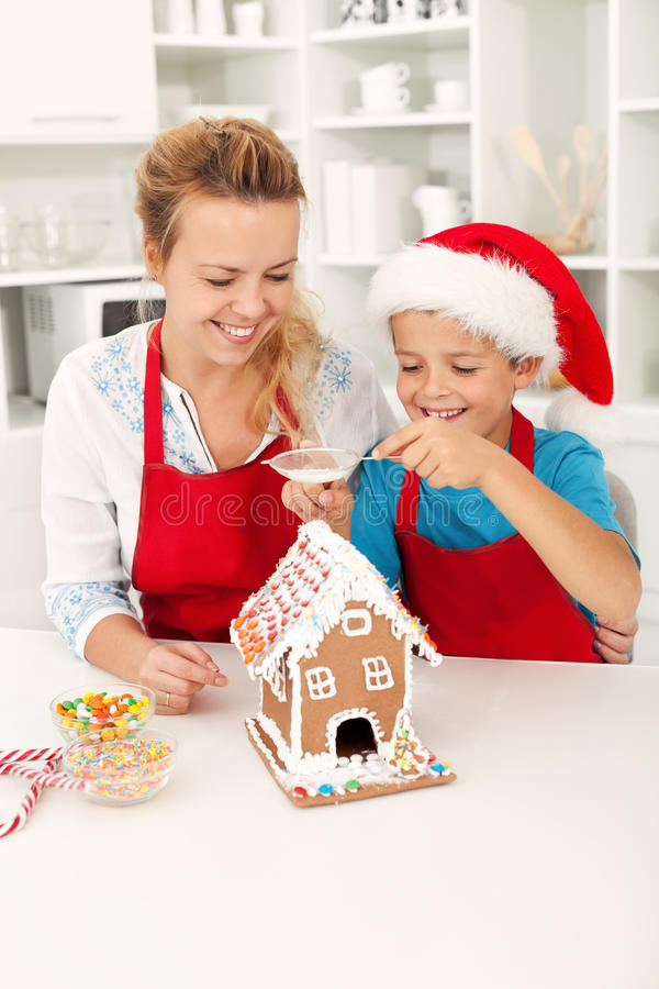 Free Final Touches On The Gingerbread House Stock Images - 21337704