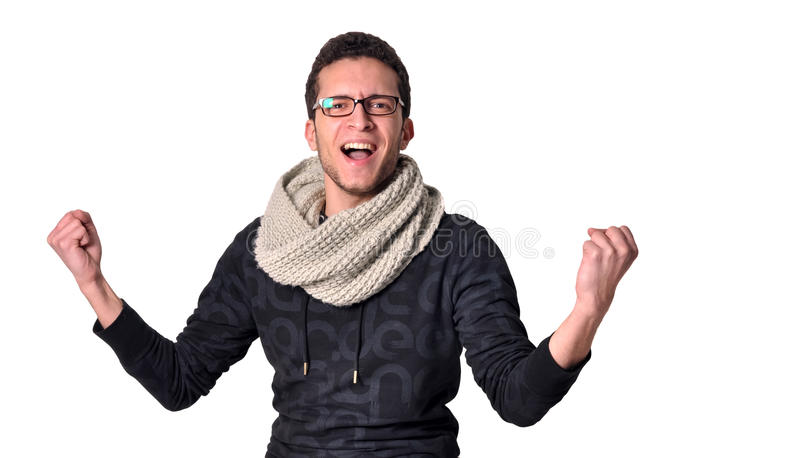 Finally. A teenager, with a scarf, expressing happiness that finally he succeeded at something stock image
