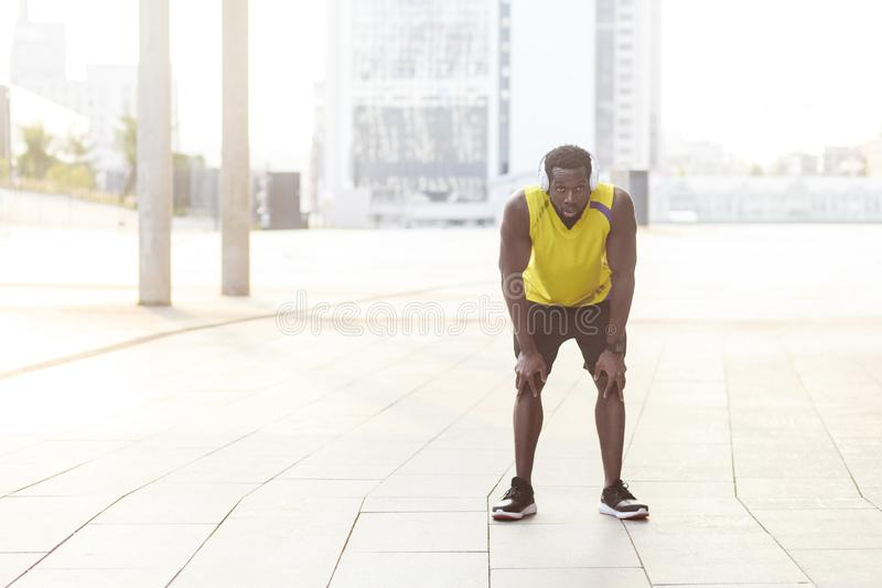 Finally finish. Sporty african man resting after workout exercise. stock image