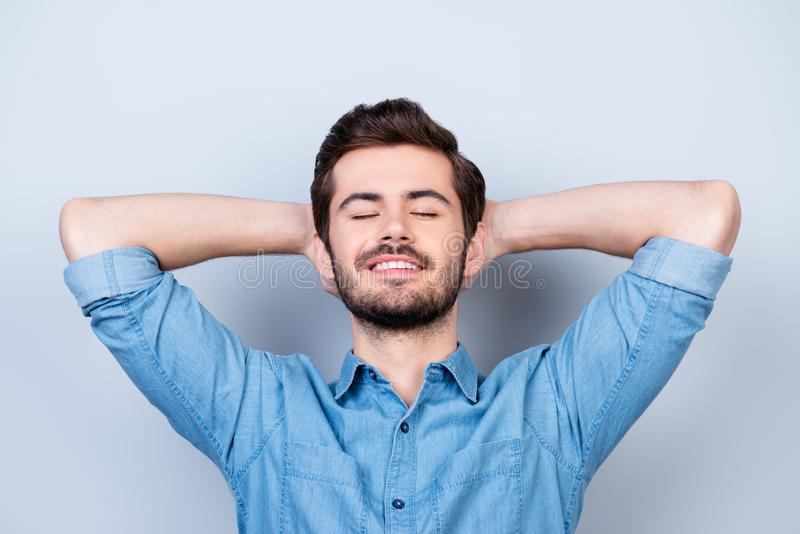 Finally rest! Close up portrait of young peaceful man in jeans s stock images