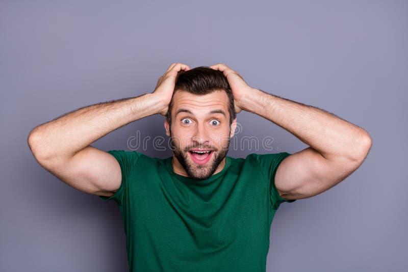 Finally world defeat corona virus. Astonished man hear wonderful novelty cant believe touch hands head stare stupor wear. Finally world defeat corona virus stock image