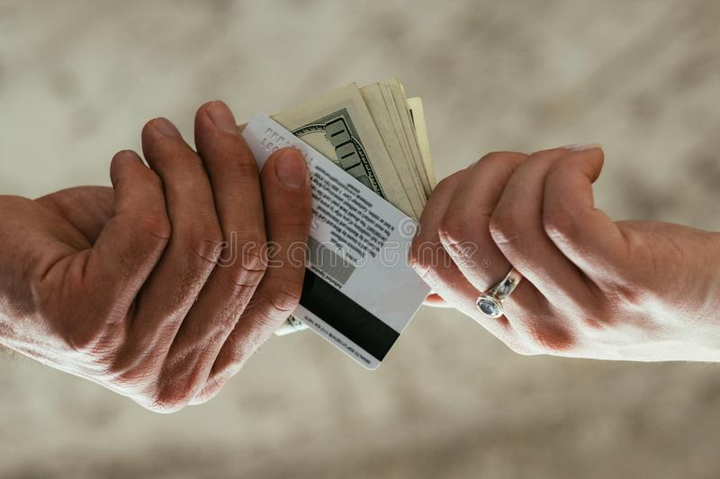 Finance accounting fraud illegal money withdrawal. Financial and accounting fraud. illegal money withdrawal. tax dodging. two pairs of hands exchanging stock images