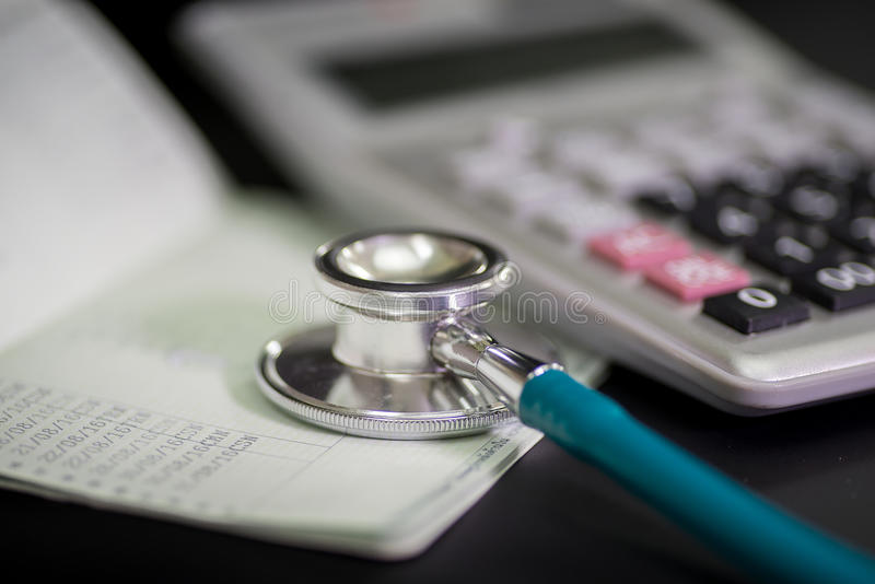 Finance accounting Medical treatment ,Stethoscope and calculator royalty free stock photos