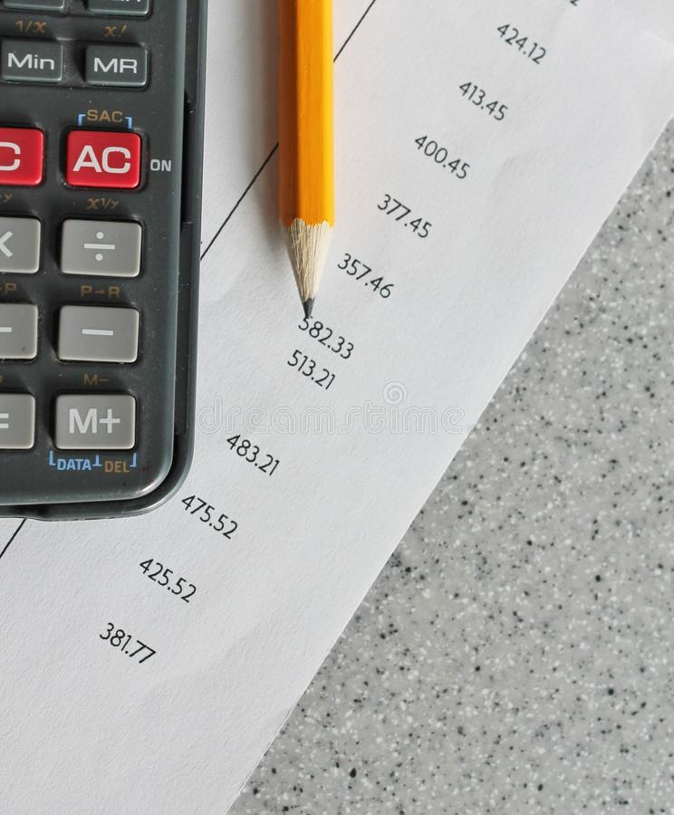Finance bank statement. Bank statement with pencil and calculator royalty free stock photos