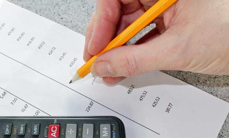 Maths finance bank statement calculator tax time. Maths tax Bank statement with pencil and calculator royalty free stock images