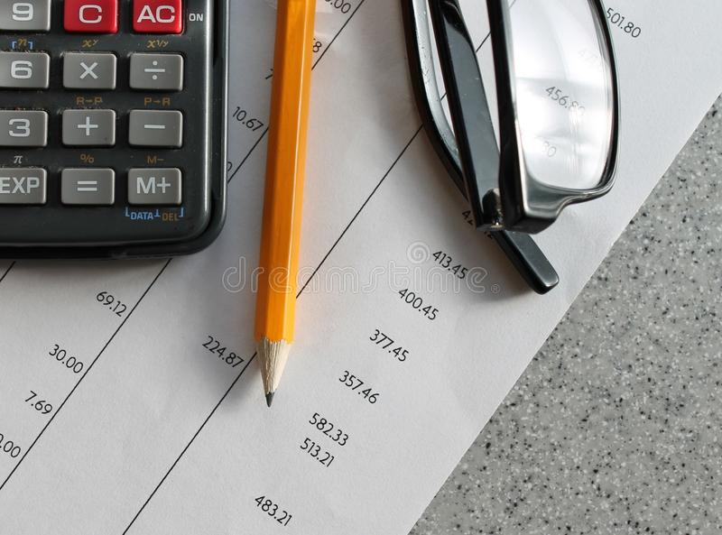 Finance bank statement. Bank statement with pencil glasses and calculator royalty free stock images