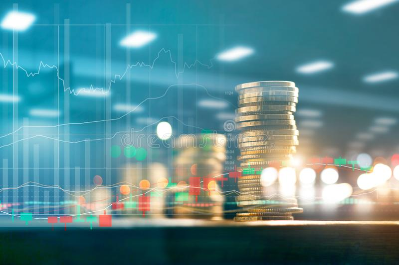 Finance and business investment concept. Graph and coins rows royalty free stock image