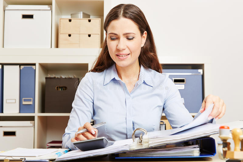 Finance clerk calculating financing royalty free stock photos