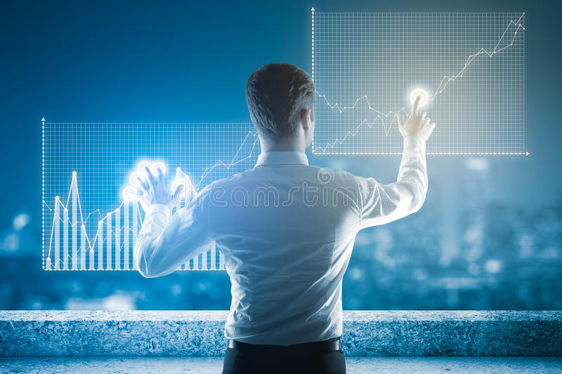 Finance concept. Back view of young businessman on rooftop managing business charts. Finance concept stock images
