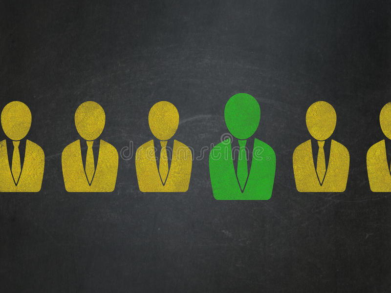 Finance concept: business man icon on School Board. Finance concept: row of Painted yellow business man icons around green business man icon on School Board royalty free stock photo
