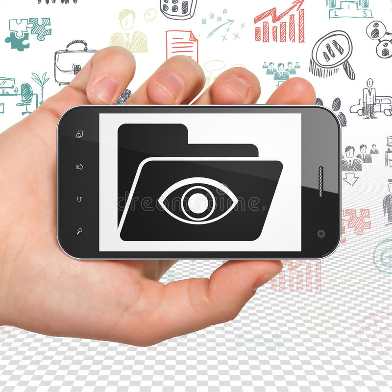 Finance concept: Hand Holding Smartphone with Folder With Eye on display. Finance concept: Hand Holding Smartphone with black Folder With Eye icon on display royalty free stock photos