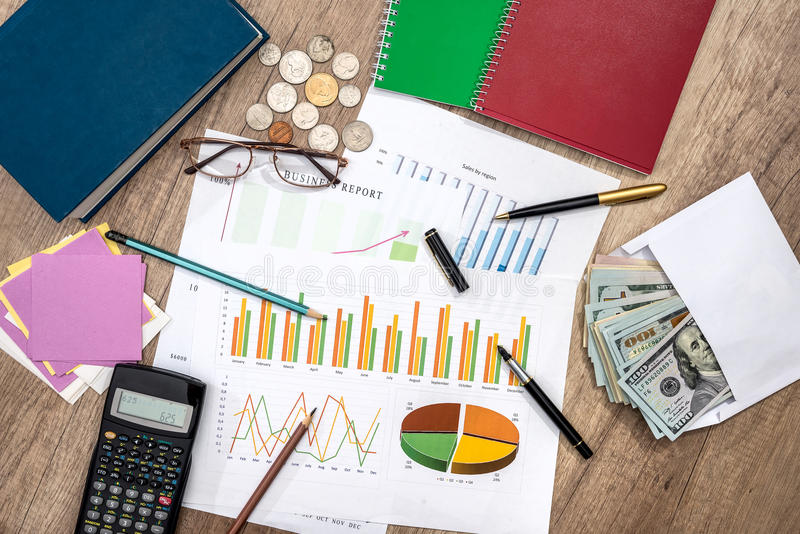 money, business graph, pen, notepad, calculator stock image