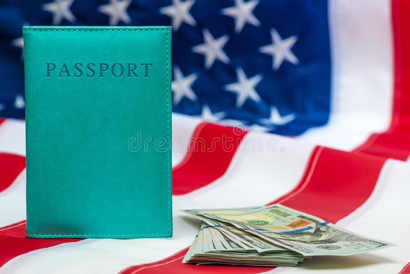 Finance concept passport, money on the national flag of the United States close-up. Objects royalty free stock image