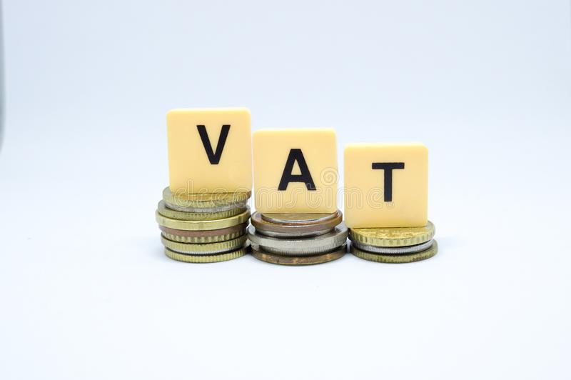 Finance Concept with Stack of Coins - VAT Value Added Tax written on.  stock photo