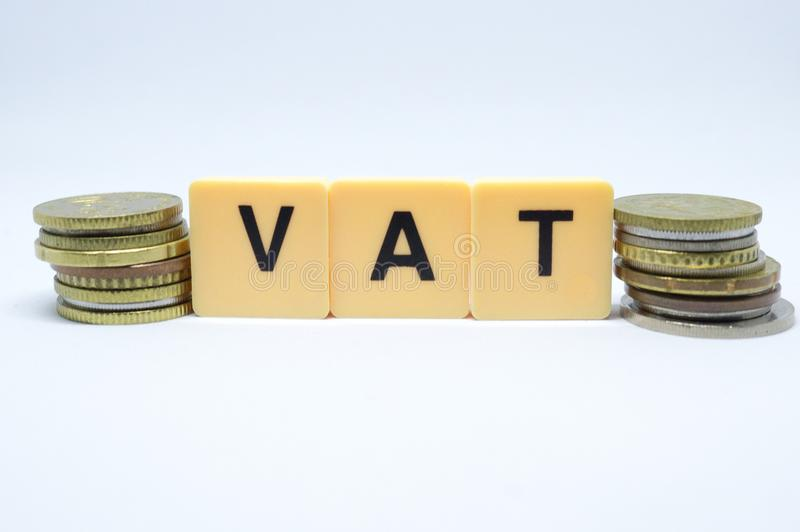 Finance Concept with Stack of Coins - VAT Value Added Tax written on.  royalty free stock photos