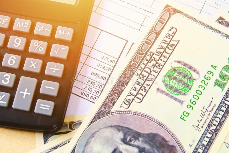 Finance concept. United States hundred-dollar bills , calculator , bills. Finance concept. The United States hundred-dollar bills , calculator , bills stock photos