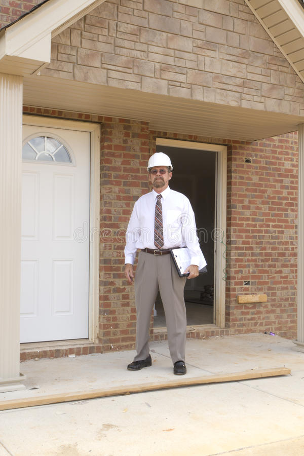 Finance Construction Director. Bank finance personal inspecting new apartment complex that his company financed stock photography
