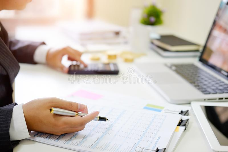 Finance control close up hand analysis financial data in document paper. Finance control close up hand analysis financial data in document paper on table stock image