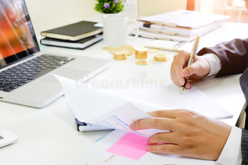 Finance control close up hand analysis financial data in document paper. About Finance control close up hand analysis financial data in document paper royalty free stock images