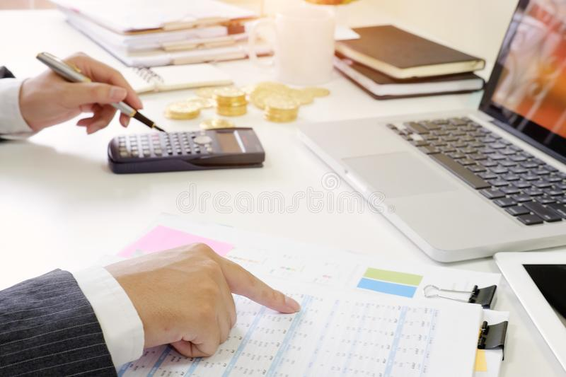Finance control close up hand analysis financial data in document paper. royalty free stock photo