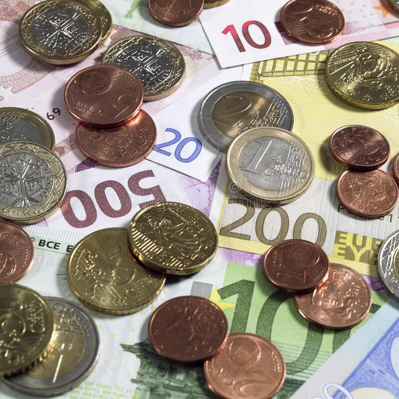 Euro Coins on 10, 20, 100, 200, and 500 Euro Bank Notes stock images