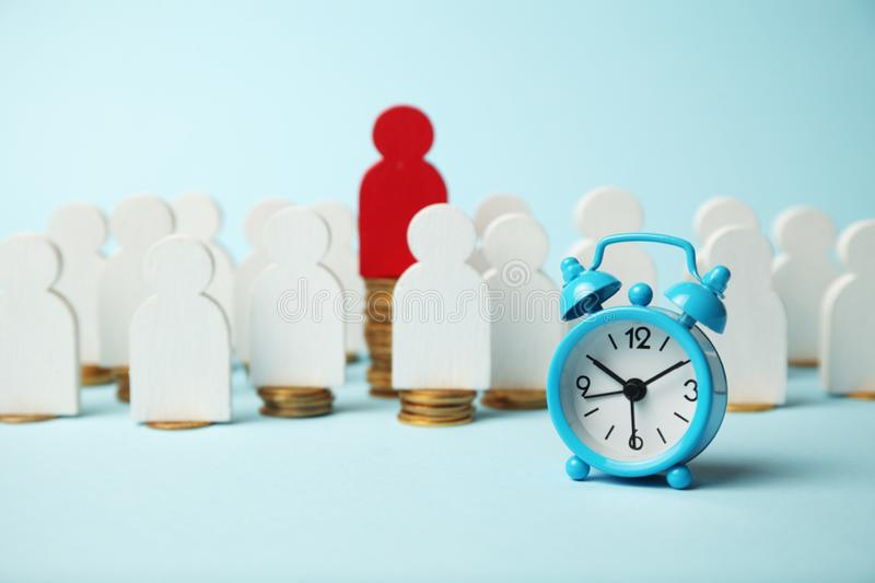 Finance investment, Time is money. Alarm clock and golden money coins, pension stock photo