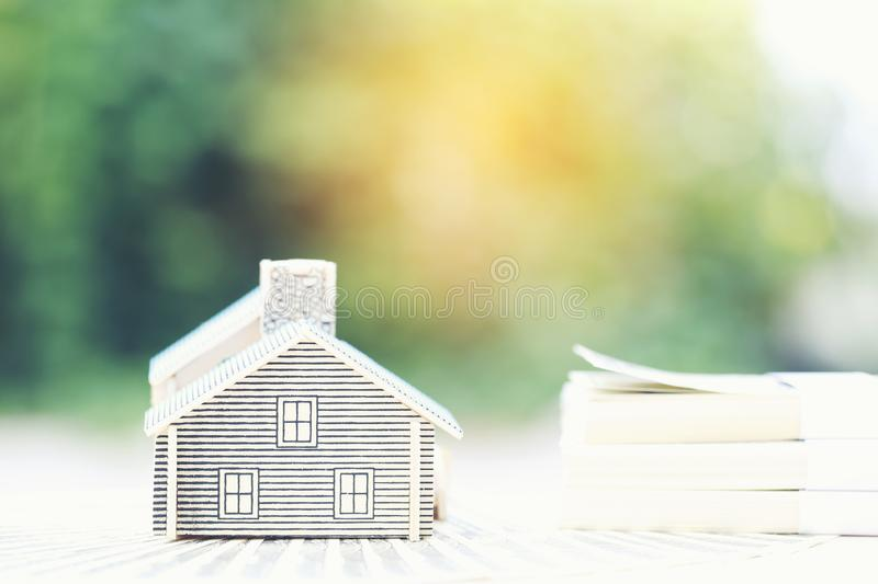 Finance, Model house on banknote on natural green background, Business investment and real estate.  stock photo