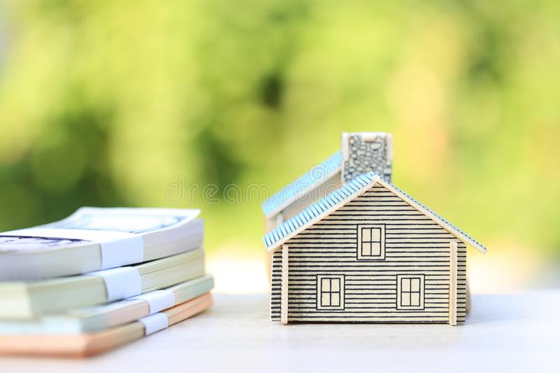 Finance, Model house and banknote on natural green background, Business investment and real estate.  stock photos