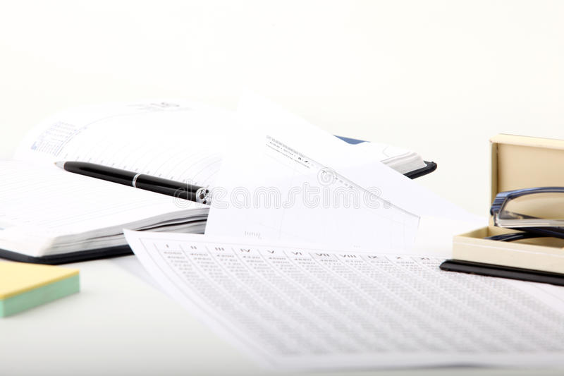 Finance notepad and documentation. Finance notepad with black pen on white paper stock photos