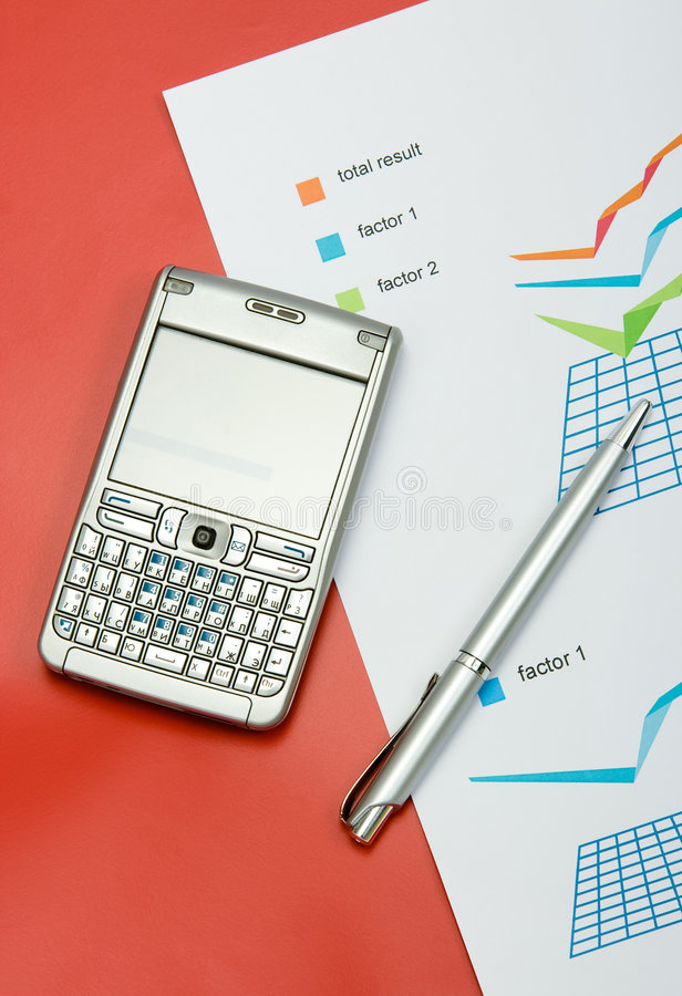 Finance report with a pen and mobile