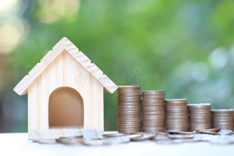 Finance, Stack of coins money and Model house on natural green background, Business investment and real estate.  royalty free stock photography