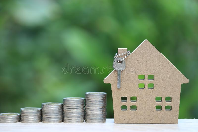 Finance, Stack of coins money and Model house on natural green background, Business investment and real estate.  stock photos