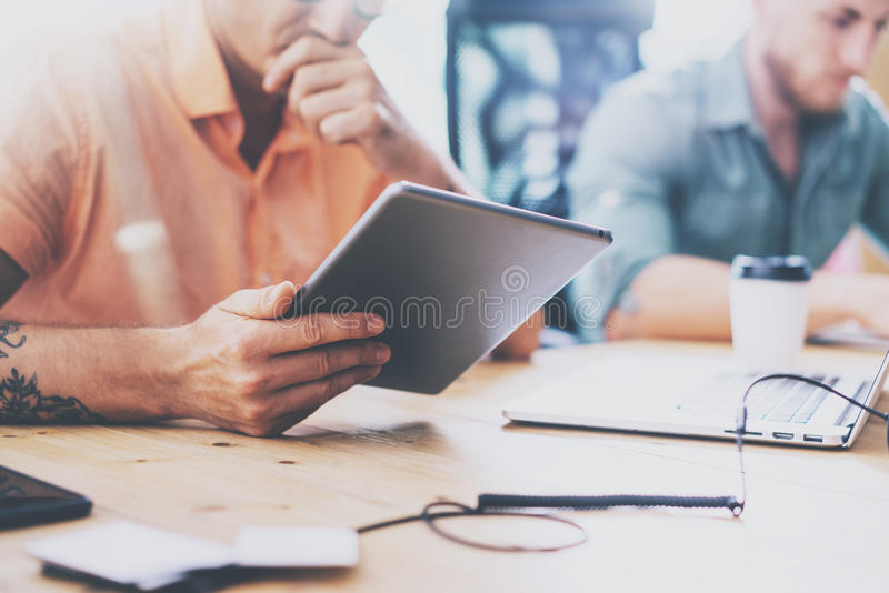 Finance Trade Managers Working Wood Table Laptop Modern Interior Design Loft.Coworkers Work Office Studio.Two Hipsters royalty free stock photos