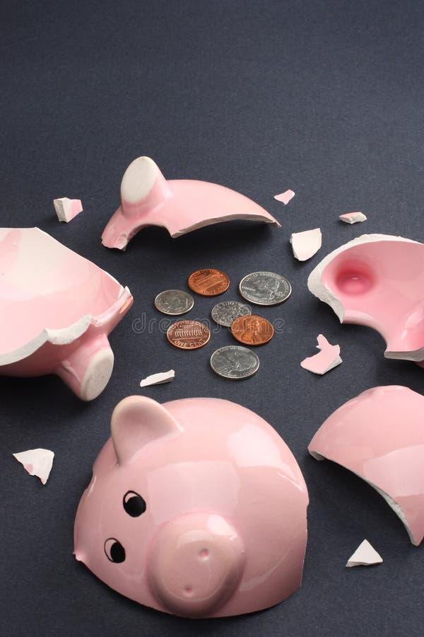 finances de concept cassées par côté d'affaires porcines photos stock