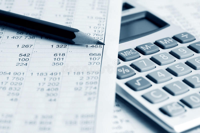 Financial accounting. Calculator and financial reports analysis stock image