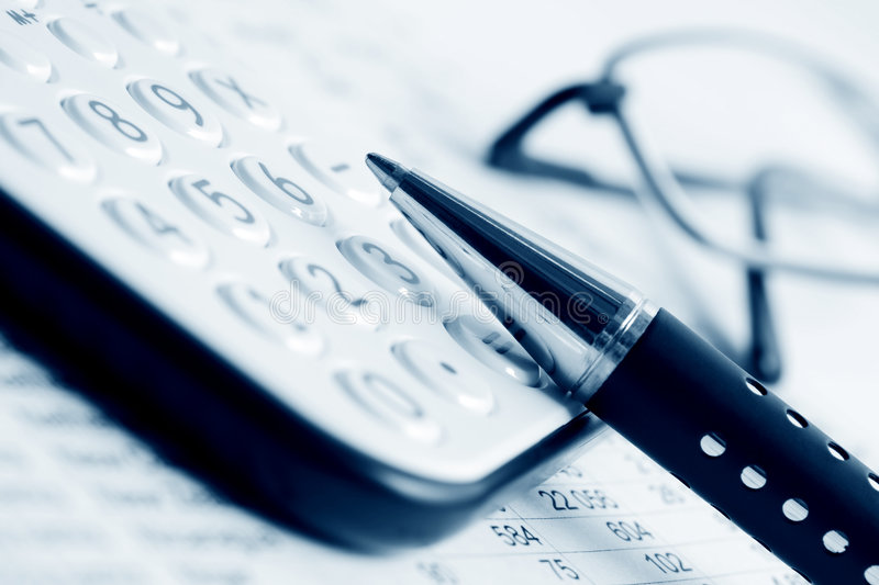 Financial accounting. Close up of pen and calculator stock photo