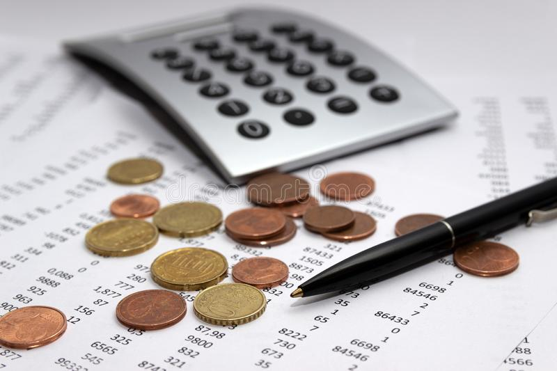 Financial accounting, Image a plurality of numbers on paper and calculator, coins. Financial accounting, Image a plurality of numbers on paper and calculator royalty free stock photo