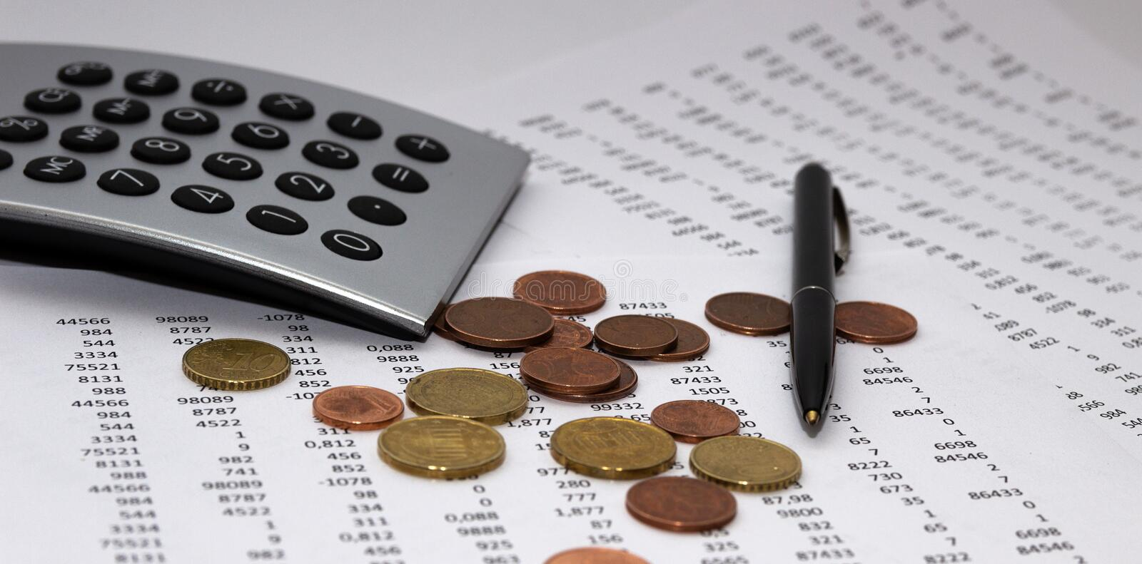 Financial accounting, Image a plurality of numbers on paper and calculator, coins. Financial accounting, Image a plurality of numbers on paper and calculator stock photos