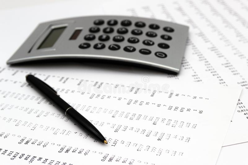 Financial accounting, Image a plurality of numbers on paper and calculator. Financial accounting, Image a plurality of numbers on paper and calculator, Numbers stock photography
