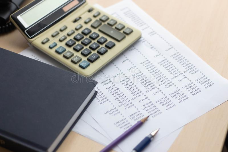 Financial accounting report with book and calculator royalty free stock photos