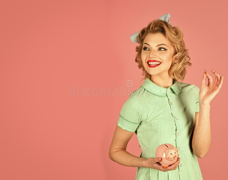Financial Accounting. Retro woman hold moneybox, piggy bank for savings. stock photography