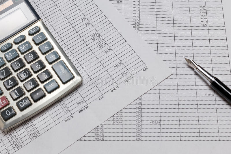 Financial accounting with tax papers, pen and calculator. Close up, flat lay style stock images