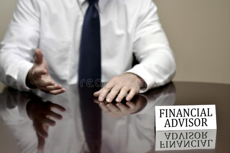 Financial Advisor Business Man Businessman Helping with Finances. Financial advisor man business businessman at desk with sign helping finances stock images