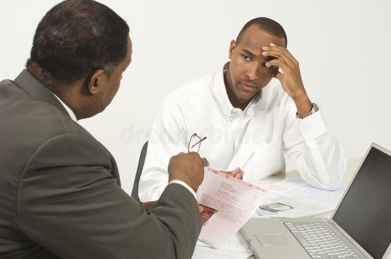 Financial Advisor In Discussion With Tensed Businessman stock photo