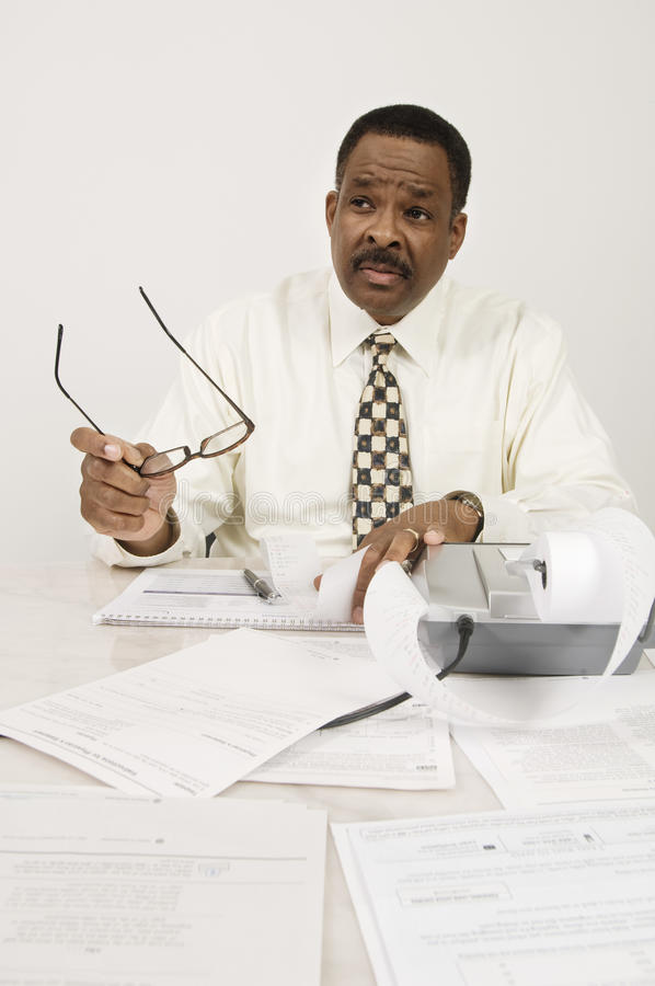 Financial Advisor With Expense Receipt In Office Royalty Free Stock Image