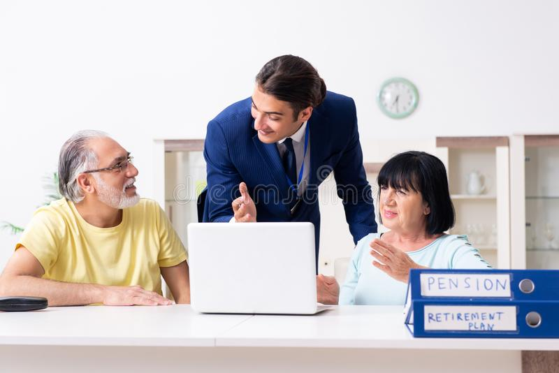 Financial advisor giving retirement advice to old couple. The financial advisor giving retirement advice to old couple stock photo