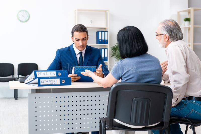 Financial advisor giving retirement advice to old couple stock photography